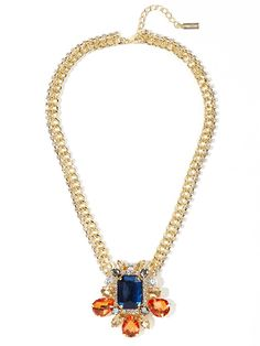 This gorgeous and graphic stunner works a bright and bold vibe with one spectacular sapphire-colored stone and copious amounts of warm, topaz-hued gems.