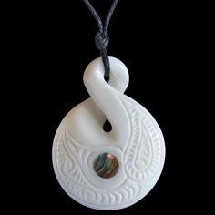 New Zealand hand crafted Maori style engraved single twist bone carving necklace with Paua shell (Abalone) inlay. Paua Shell, Abalone Shell, Singles Twist, Bone Carving, Bones, Shells, Christmas Ornaments, Pendant, Holiday Decor