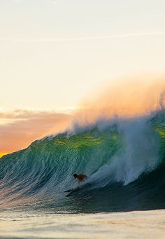 surfing-the-salt-life:  Koa Smith grabs rail at dusk, closing shop on the first of many good days to come on the North Shore of Oahu.  Photo...