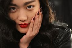 Noon by Noor: The oxblood manicure at Noon by Noor's Fall 2013 show got a sparkling update with red crystal accents.