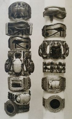 Thirteen bracelets were found on the forearms of the mummy of King Tutankhamun. Seven on the right arm, and six on the left. Several of the bracelets included scarabs separated by motifs such as uraei and ankhs some have a large amuletic udjat eye or another central element. The bracelets were made of gold, multi coloured glass, faïence, and semiprecious stones. (MMA Burton photo TAA1382)