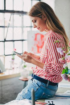 Businesswoman Texting on Her Cell Phone by Lumina for Stocksy United
