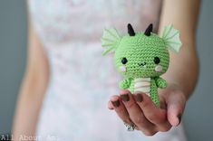"""Crochet your own adorable baby dragon using this crochet pattern which is a part of our Chinese New Year series! This pattern contains clearly explained instructions and pictures to help you crochet this dragon complete with little wings, horns, and a scaled belly! His kawaii face makes him the cutest Dragon you'll ever see! The pattern is written in US crochet terminology and the finished dimensions are 4""""/10.2 cm tall tall and 3.5""""/8.9 cm wide from wing to wing. The..."""