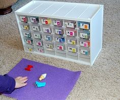 For instance, theP drawer has:  Oneplastic letterP, a small parrot, pineapple, penguin, panther, pin and phone.