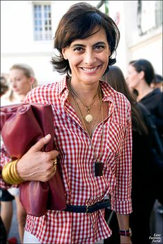 "Ines de la Fressange, I can't say her name but I love her style.  I also love her book ""Parisian Chic""."