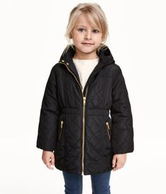 Lightly padded jacket with quilted sections. Detachable hood with faux fur lining, elastication at waist and at cuffs, front zip, and side pockets with zip. Lined.