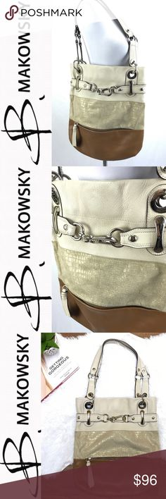B. Makowsky Genuine Leather Hobo Handbag Tan, Gold shimmer, Camel. Silver hardware. Size: Large Side to side Width: 14 Top to bottom Legnth: 15.5 100% Genuine Leather Body & Trim 100% Polyester Lining Made in China Interior animal print with pockets Condition: Preloved & one small light spot on very bottom. see all photos and use zoom feature, as they are used as part of item description. measurements are approx and are in inches taken while laying flat. Check out the rest of my closet and…