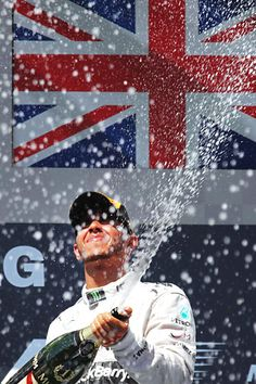 Lewis Hamilton of Great Britain and Mercedes GP celebrates on the podium after winning the Hungarian Formula One Grand Prix F1 Lewis Hamilton, Lewis Hamilton Formula 1, Mercedes Gp, F1 Racing, Drag Racing, British Sports, Formula 1 Car, Racing Events, Sports Stars