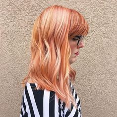 Pretty peach and pink shades intermingle in this Aveda hair color by Pavo Salon.