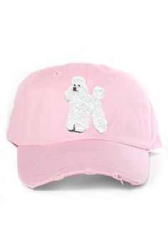"""The """"Poodle"""" is embroidered and featured on a light pinkunstructured hat with an adjustable strap band. Returns and Exchanges Policy Shipping Specification: Pl"""