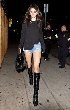 Kendall Jenner Wore Crazy-Short Shorts With Knee-High Boots at a Club via @WhoWhatWear