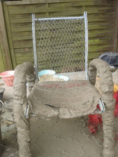 Dip fabric in thin concrete, and put it on,the whole chair, and let it dry