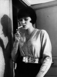 "Actress Anna Karina (b. in Jean-Luc Godard's film, ""Vivre sa vie,"" 1962 Anna Karina, Women Smoking, Girl Smoking, Le Smoking, Smoking Room, New Wave Cinema, French New Wave, Jean Luc Godard, Beatnik"