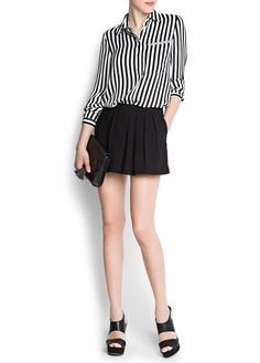 Pleated shorts and vertical stripes