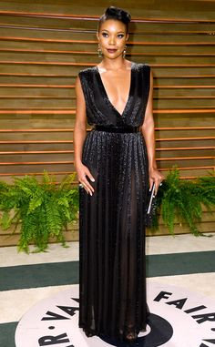 Gabrielle Union rocks a daring and décolletage-baring gown at the 2014 Vanity Fair Oscar party!