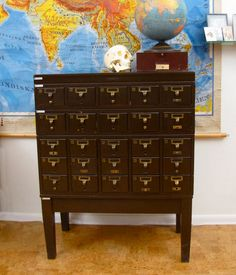 I so badly want an old card catalog for my house. Oh, the things you could organize in all those little drawers!