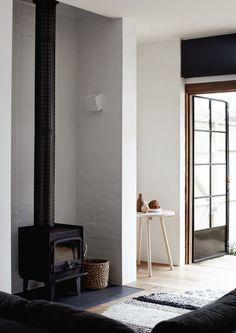 Simple wood burner in a white room