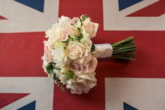 Blush rose bouquet on union jack flag for a jesmond mansion house wedding. image by andy hudson photography flowers by fleur couture