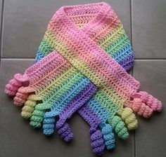 Ravelry: Free Crochet pattern for a curly scarf with the increasingly iconic ringlet curls at the end.