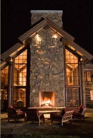 love the windows, the giant chimney and the outside fire place