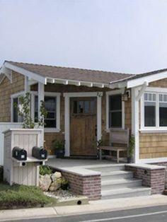 Craftsman-style mobile home & porch at the Point Dume Club in Malibu, CA via MHVillage.  #mobilehome #porch