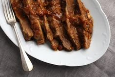 A classic Jewish staple, brisket is slow-cooked for optimum tenderness and flavor. Here the meat is first coated with a Hungarian paprika rub, then slow-cooked with tomatoes, onion, and rosemary. The addition of brown sugar and vinegar lends a sweet-savory balance to the deep, meaty flavor.