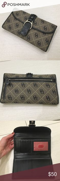 Dooney & Bourke Wallet Barely used Dooney & Bourke logo wallet with black/red leather interior. Clean. No stains on fabric. Great deal. Well kept. Several credit card slots and has space for a checkbook. Dooney & Bourke Bags Wallets