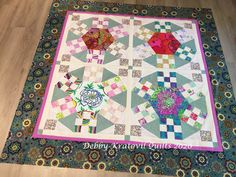 "Upsized 22"" blocks make this 64"" quilt quite a beauty! Featuring large scale Kaffe Fassett prints in the block centers adds to the beauty, Quilt Block Patterns, Pattern Blocks, Quilt Blocks, Block Center, Freezer Paper, Strip Quilts, Acrylic Wool, Large Prints, Hand Sewing"