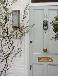 Beautiful door and white brick combo