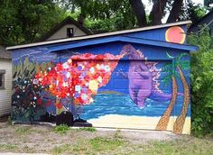 A handful of middle school kids in my area painted this Godzilla mural to cover up some garage door graffiti. YES!