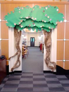 """Archway decorated as tree for kids to """"burrow into"""" the Youth Services department for Dig Into Reading Summer Reading 2013. Messenger Public Library, North Aurora, Illinois."""