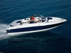 Breezin' along the lake in our Four Winns boat!  Looks like us at the lake when the water is smooth.....