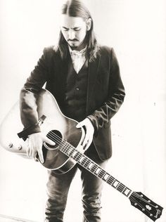 Dhani Harrison holding his father's guitar.