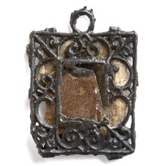 Small mirror in rectangular frame decorated with scrollwork