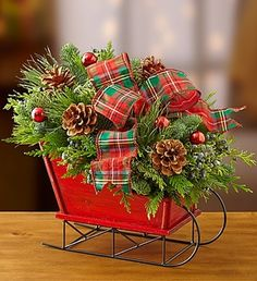 Christmas Sleigh with Fresh Evergreens #Christmas #Flowers