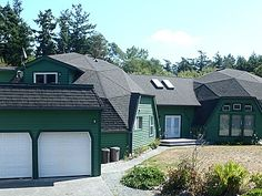 """1028 Custer St, Oak Harbor, WA 98277 $475,000 4b3.5ba 6000sqft 2.5ac Large rooms throughout this double geodesic dome house. 900sq'+ greatroom with pool table, full bar, full bath, 60"""" HDTV & deck. Formal dining room. Formal living room. Master loft bedroom with private deck & walk in closet. Playroom, 3 bedrooms & full bath in """"kids wing"""". TimberTech decks. RV parking & electric. Storage shed. Riding Mower. 2 1/2 fenced acres. Appliances included. Furniture & 34' 5th wheel negotiable"""