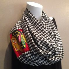 This scarf is gorgeous for a Blackhawks fan. A black and white cashmere feel scarf infused with a recycled Blackhawks T-shirt. This is