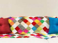 Learn How to Crochet an Afghan in Kaleidoscope Color! This amazing beginner crochet tutorial will teach you how to make an afghan in vibrant colors! | AllFreeCrochetAfghanPatterns.com