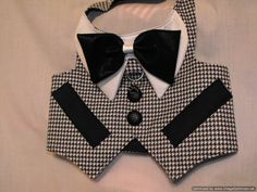 this tuxedo is made of soft flannel and lined with cotton. the first picture has a black leather bowtie and the second is a black swirl cotton