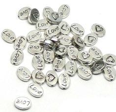 Rockin Beads Brand, 38 Oval Love Heart 8x10mm Antiqued Silver Beads Cast Zinc Metal Spacer Beads (Approx 1.2mm Hole) Rockin Beads (TM) http://www.amazon.com/dp/B00JDLV0JM/ref=cm_sw_r_pi_dp_kTacub1H1BP75