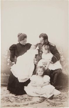 Family portrait: Nicholas and Alexandra with their young burgeoning family.  Quite a bundle full of little ones.