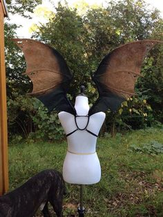 This listing is for a pair of custom deluxe dragon wings. They are larger and more detailed than the other dragon wings I offer. They are