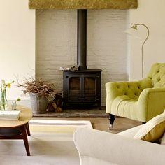 White brick walls, black fireplace stove
