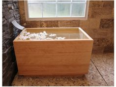 Japanese soaking tub with interesting tap system, from houzz
