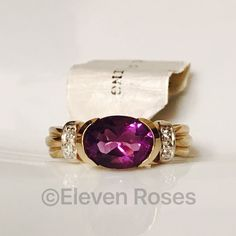 NWT 14k Yellow Gold Amethyst & Diamond Ring 14k Gold Amethyst Ring With Diamond Accents - Fluted Ribbon Band Design - 585 14k Yellow Gold - Tension Set, Half Bezel Setting - Oval Amethyst Gemstone Measures Approx 9 X 7mm (approx 2.5 CTW) - Hallmarked; 14k - US Size 7 - New With Tags (new old stock) Fine Jewelry Jewelry Rings
