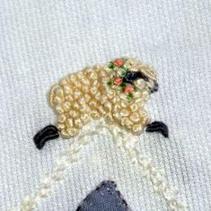 French knot lambs on little lamb daygown #embroidery #embellishment