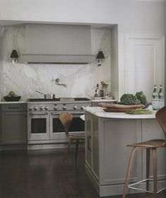gray cabinets, marble slab backsplash, sconces
