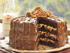 Chocolate, caramel, and pecans are made to be together, and their flavors harmonize perfectly in this stunning chocolate layer cake....