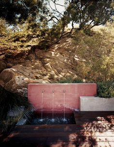 An outdoor water feature adds a subtle soundtrack to the property while keeping the plants irrigated. Photo by: Misha Gravenor