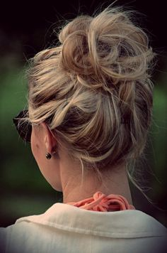 Loose high bun hairstyle.